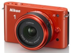 Nikon 1 J2 orange mit Objektiv 11-27.5mm 3.5-5.6 (VVA166K005)